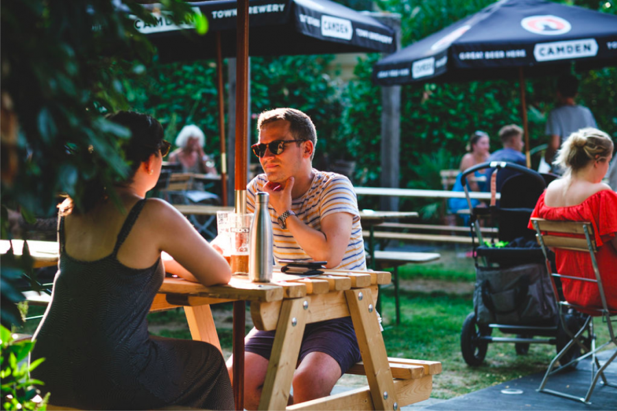 Customers sat outside in our beer garden enjoying drinks.